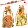 Almonds and Chocolate Net Pouch with Red Pearl Rakhi